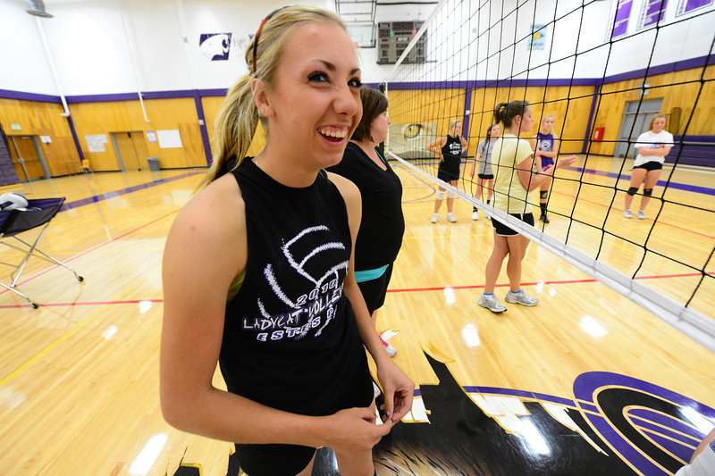 Walt Hester   Trail-Gazette<br /> Amanda Dill flashes a slightley selfconscious smile before stretching at the volunteer volleyball workout on Wednesday. Up beat and hard working, Amanda Dill hopes to lead her volleyball team by example.