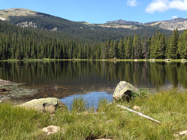 The glassy smooth waters of Finch Lake in the Wild Basin area of Rocky Mountain National Park.