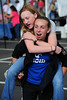 Walt Hester | Trail-Gazette<br /> Rachael Prawitz, 14, of Parkville, Kans. carries friend Emily Ann Schwinn, 14, of Lansing, Kans. through the Estes Valley Farmers Market on Thursday. The pair were in town for the Hunter-Jumper show at the fairgrounds.