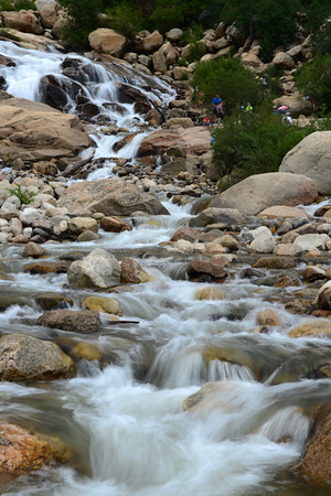 Walt Hester | Trail-Gazette<br /> Visitors pose at the Alluvial Fan on Wednesday. The cascade in the west end of Horseshoe Park is one of the most visited attraction in the park.