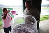 Walt Hester | Trail-Gazette<br /> Ray Couca spins and dispences cotton candy at the NLC picnic on Saturday. The event brought together children, parents amd grandparents to Stanley Park.