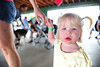 Walt Hester   Trail-Gazette<br /> Aspen Bockman, 1 and a half, seems to be fading toward the end of Saturday's New Life Center Picnic at Stanley Park.