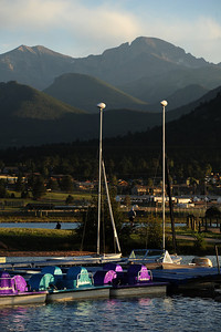 Walt Hester | Trail-Gazette Warm summer evening sun casts long shaddows across Longs Peak and the Lake Estes Marina on Thursday evening. WIth the long summer daylight, families spend plenty of time out around the lake.