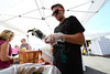 Walt Hester | Trail-Gazette<br /> Cory Scofield of Scofield Farms bags Anaheim chilis at the Estes Valley Farmers Market on Thursday. The smells of autumn are begining to fill the air of the marklet, which continues through September.