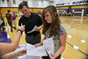 Walt Hester | Trail-Gazette<br /> Eighth-grader to-be Christine Kearsley seems less than excited to register for the 2012-'13 schoolyear. School begins at the high school and middle school on Monday, August 20.