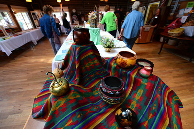 Walt Hester | Trail-Gazette Crafts and art spread over tables inside as well as outside at the Hilltop House on Saturday. The bazaar encompesses so much stuff, it spills out to the house's yard.
