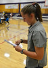 Walt Hester | Trail-Gazette<br /> An Estes Park student looks over her new school ID on Wednesday. Students from both the high school and middle school registered for the upcoming school year this week.