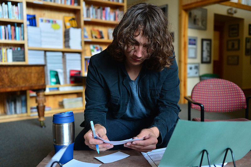 Walt Hester | Trail-Gazette<br /> Eagle Rock student Dillon Powell organizes notecards for his presentation of learning on Tuesday. The school offers at-risk youth an opportunity to excell in a non-traditional learning environment.