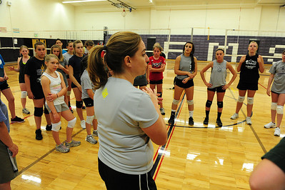 Walt Hester | Trail-Gazette Volleyball coach Sammi Coleson addresses her charges after an open gym workout on Wednesday. The coach noticed the improvement of the girls who spent extra time in the gym over the summer.