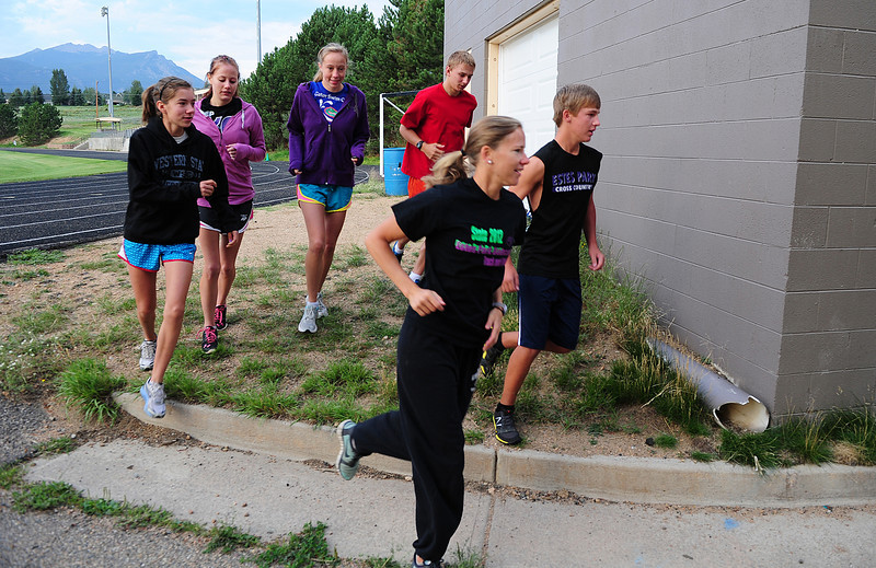 Walt Hester | Trail-Gazette<br /> Coach Ruby Bode leads her team out on a warmup run on Monday. The group had last week off and is raring to go.