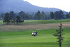 Walt Hester | Trail-Gazette<br /> Golfers play through as afternoon rain rolls through on Wednesday. While rain has been a daily event for weeks, its usually brief.