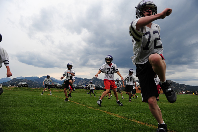 Walt Hester | Trail-Gazette<br /> Football players begin the season with footwork on Monday. The team begins practice without pads to give players a chance to get fit before getting hit.