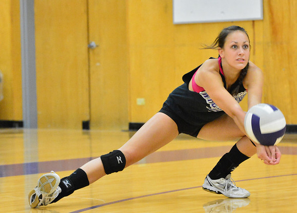 Walt Hester | Trail-Gazette<br /> Erin Barker digs out a hit during volleyball tryouts on Monday. The 17-year-old should be one of the leaders in this years team.