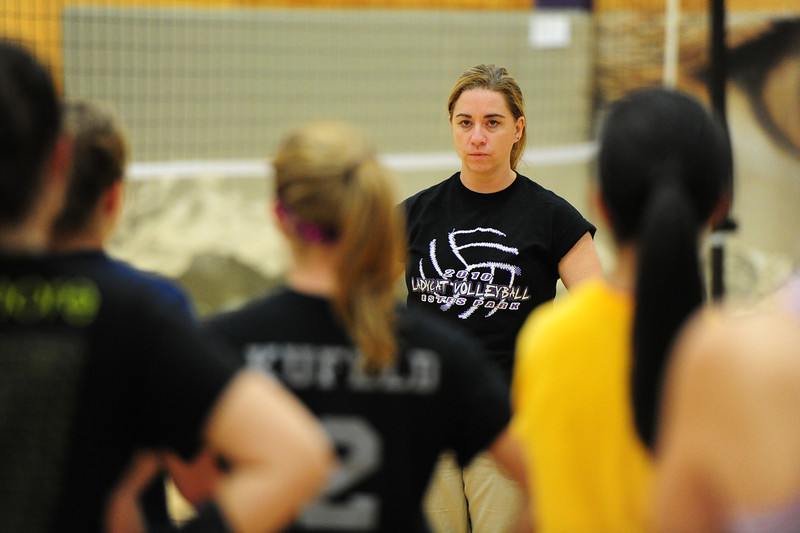 Walt Hester | Trail-Gazette<br /> Head volleyball coach Sammi Coleson explains drills to the Ladycats during the evening session of pre-season volleyball practice on Wednesday. Coleson's main focus this season is to change the team mindset to that of winners.