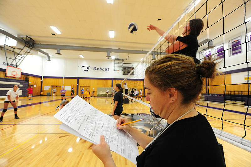 Walt Hester | Trail-Gazette<br /> Head volleyball coach Sammi Coleson rates defensive play at tryouts on Monday morning. No one's place is assured as a new season begins.