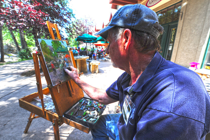 Walt Hester | Trail-Gazette<br /> Plein Air painter Mike Beeman of Cheyenne, Wyo. paints along the Riverwalk on Sunday. The painters will be more visible as the annual outdoor painting festival draws near.