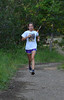 Walt Hester | Trail-Gazette<br /> Junior Kelsi Lasota runs a shady trail early on Tuesday. After placing ninth in last years state cross country meet, and setting several distance running records during track season, Lasota wants to place in the top three at this year's meet.