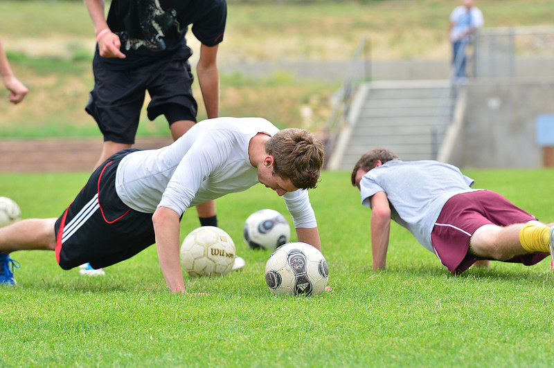 Walt Hester | Trail-Gazette<br /> Footballers pay the price for colliding during drills on Monday. Players must be able to control the ball and themselves to be successful.