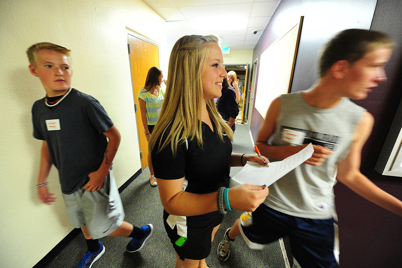 Walt Hester | Trail-Gazette<br /> Emily SHields, 16, of the Estes Park High Schools Students' Union guides incoming freshman around the school on a scavenger hunt. The game helped the students find the rooms they will need to know when they start school next week.