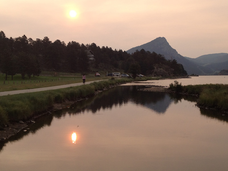Sunshine pierces the wildfire haze over Estes Park on Wednesday. Possible rain this afternoon and a high expected to reach 80.