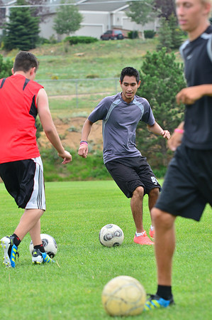Walt Hester | Trail-Gazette<br /> Jorge Morales dances around a team mate during drills on Monday. Morales will need to step up on the small team for the 'Cats to enjoy the success they had last season.