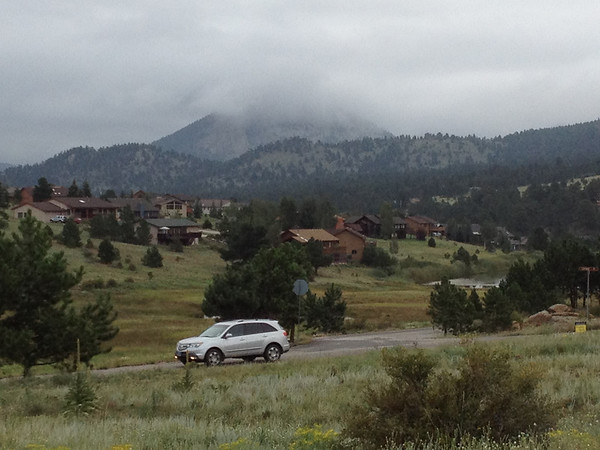 Heavy, low clouds greet commuters Thursday morning in Estes Park. Forecasters are calling for cool temperatures today, a high near 70, and a chance of more rain this afternoon.