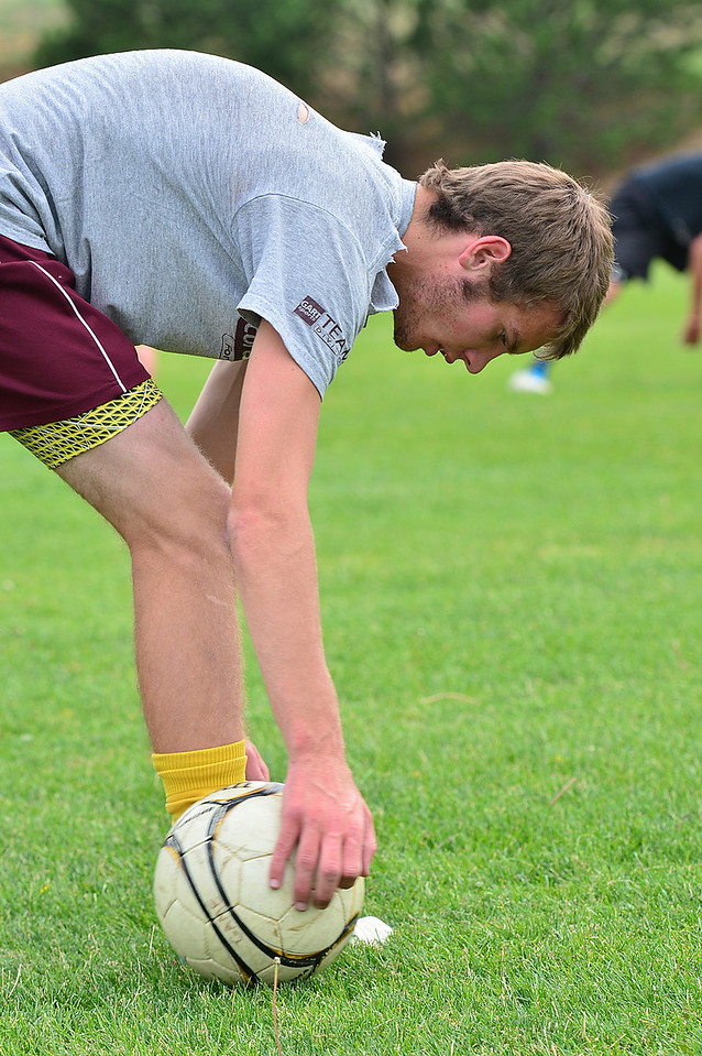 Walt Hester | Trail-Gazette<br /> Josh Hays rolls a ball around his feet as part of a leg stretch on Monday. In spite of being relatively short for a goalkeeper, Hays will be looked up to for leadership on this years team.