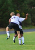 Walt Hester | Trail-Gazette<br /> Andrew Cirone tackles team mate Erick Dominguez on Tuesday after Cirone headed in the go-ahead goal from a Dominguez corner kick. The Bobcats moved to 2-1 after their win over Jefferson Academy.