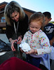 Walt Hester | Trail-Gazette<br /> Jenika Hick, 5, rings out her shirt with the help of teacher Vicki Weible at the Estes Park Elementary School on Thursday. Students at the school tie-dyed shirts a different color for each grade.