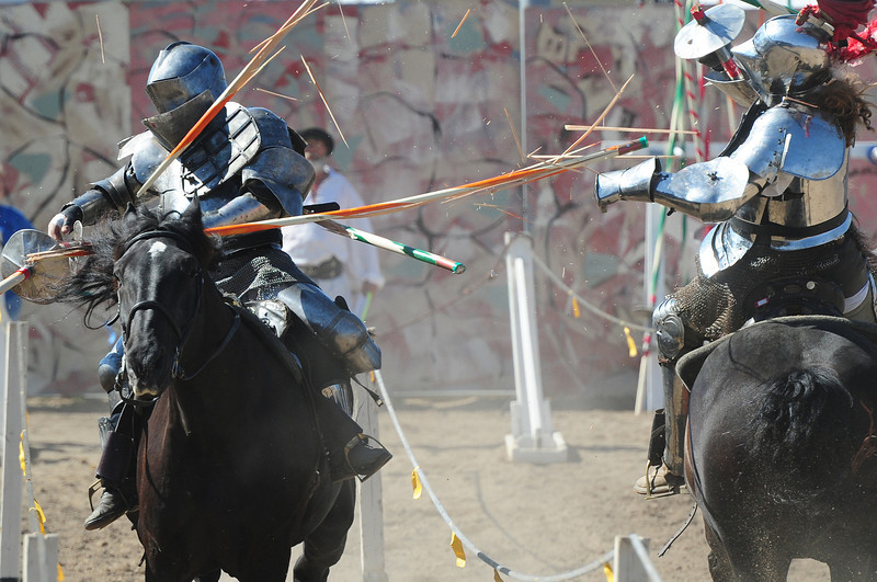 Walt Hester | Trail-Gazette<br /> A violent collision splinters lances and knocks knights off of their horses during the final day of heavy armor jousting competition on Sunday. Jousting has become so popular it warrented it's own History Chanel series and a National Geographic documentary.