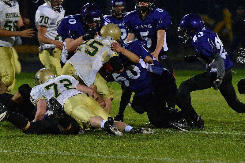 Walt Hester | Trail-Gazette<br /> Andre Gonzales and Brenden Mulhern combine to stop Highland's James Price on Friday. The Bobcat defense held the Huskies' leading rusher to 51 yards, and gave up only 69 total rushing yards on the night.