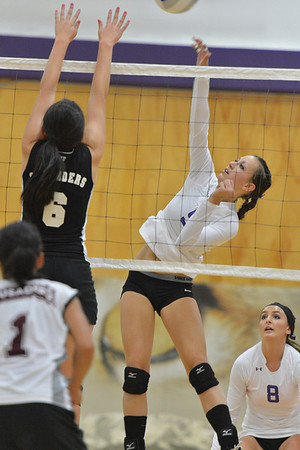 Walt Hester | Trail-Gazette<br /> Erin Barker hits in the first set of the Ladycat's match with Community Christian on Thursday. The see-saw match ended in an Estes Park win.