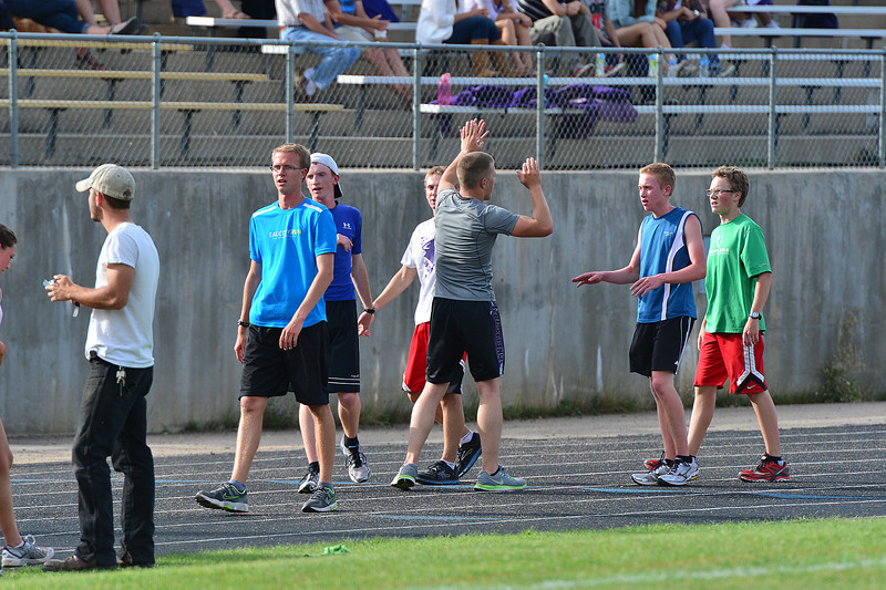 Walt Hester   Trail-Gazette<br /> Senior cross-country runner Nate Dewitt distributes high fives to team mates during last Thursday's workout. While not the fastest runner on the team, Dewitt is contributing with leadership through hard work and enthusiasm.