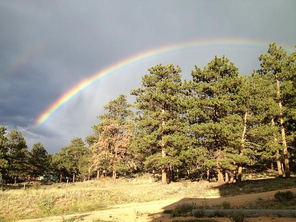 A rainbow arches across the Estes Park sky following a passing thundershower.