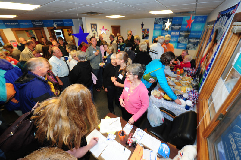 Walt Hester | Trail-Gazette<br /> Democratic supporters jam a small office in Estes Park on Wednesday night as the local campaign office officially opens. The Republicans also have a local office, but it was not yet open.