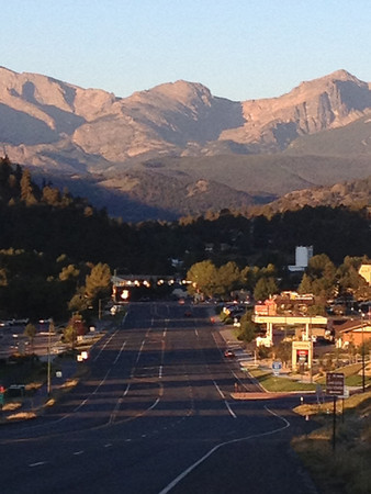 Sunrise casts a warm glow on the peaks of the national park on Monday. The work week begins warm and dry, with a high near 80.