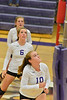 Walt Hester | Trail-Gazette<br /> Cora Young, Becky Reilly and Ali Scheil await the next volley against Frontier Academy on Tuesday. The Ladycats were close throughout, but got nudged at the end of the final set.