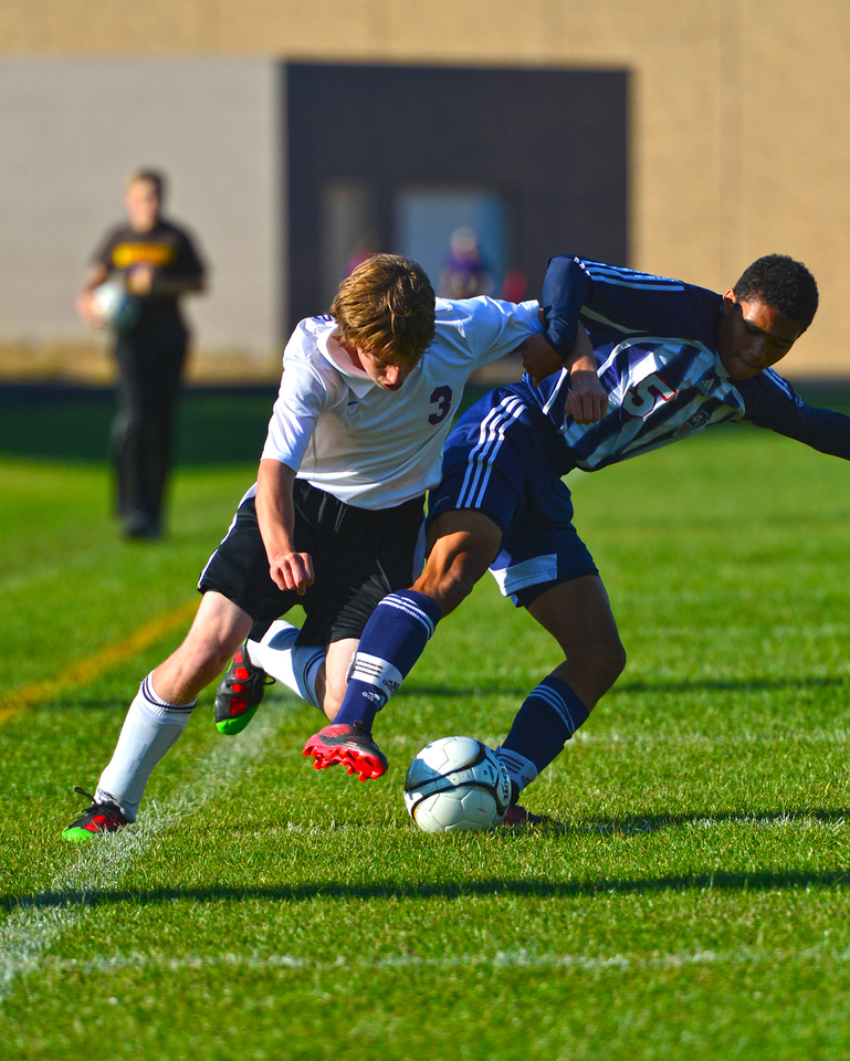 Walt Hester | Trail-Gazette<br /> Zach Pierce fights for position against Frontier Academy's Taitian Bowie on Thursday. The Bobcats could not hold off the Wolverines in spite of hard play, losing 2-0.