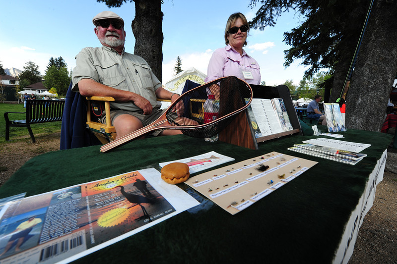 Walt Hester | Trail-Gazette<br /> Fly tiers Les and Kimall Beery of Angler's Guide enjoy the nice day downtown at the Arts and Crafts Market. Art is different for different people, and fishing flies certainly require the time and creativity of an artist.