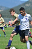 Walt Hester | Trail-Gazette<br /> Jorge Morales fends off a Nederland defender before scoring on Saturday. The goal was Morales' third on the day and helped the Bobcats beat the visiting Cougars 7-0.