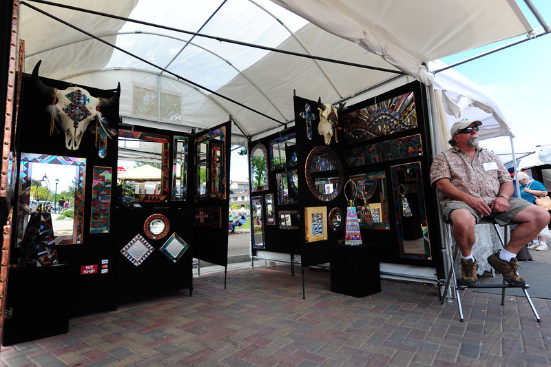 Walt Hester | Trail-Gazette<br /> Glass artist Randy Romanin of Conifer shows off his reflective work on Saturday. The market offers a wide variety of work and medium.