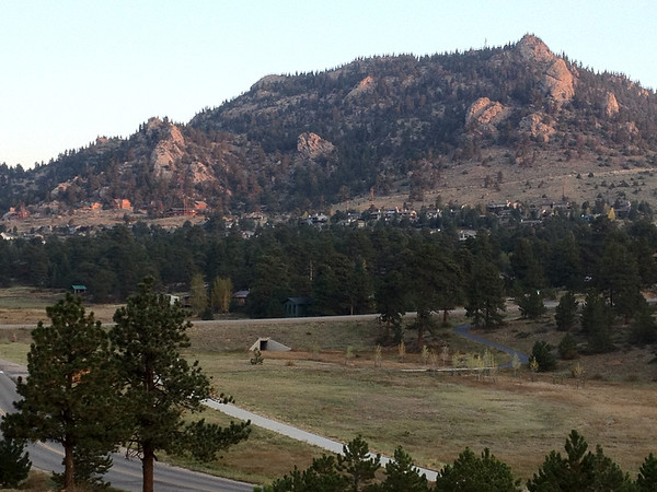 High haze continues to dull morning light in Estes Park on Thursday. Chilly morning temperatures will give way to moderate conditions later in the day with high clouds and highs near 70.