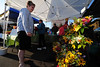 Walt Hester | Trail-Gazette<br /> Jackie Flood of Estes Park looks over the flowers at the Estes Valley Farmers Market on Thursday. Next Thursday is the last market of the season.