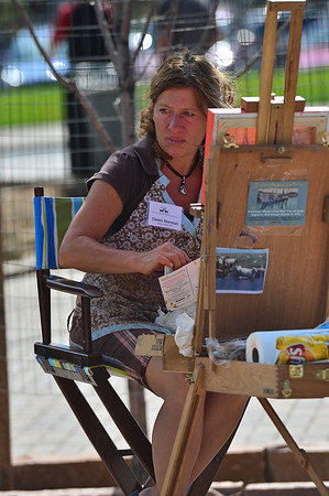 Walt Hester | Trail-Gazette<br /> Local painter Dawn Normali observes the croud at the annual Art and Craft Market in Bond Park on Saturday. A few locals were able to show their wares at the market.
