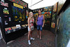 Walt Hester | Trail-Gazette<br /> Nicole Ozols, 14, and mother Terri Thompson look for hidden treasure on Saturday within the painting of artist Susan Spohn. The Art and Craft Market in Bond Park offered more than met the eye over the weekend.