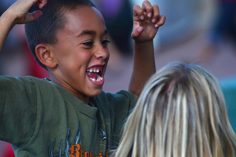Walt Hester | Trail-Gazette<br /> Reese Kloberdanz, 7, of Aurora makes faces at his mother, Kara, at the Arts and Crafts Market on Saturday. The event was family friendly and entertaining for those seeking something new for the home.