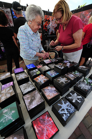 Walt Hester | Trail-Gazette<br /> Betty O'Neill and Sherry Power, both of Milwaukee, Wis., admire reproductions of snowflakes at the annual Arts and Crafts Fair on Saturday. Creativity was the only limit for artists at the fair.