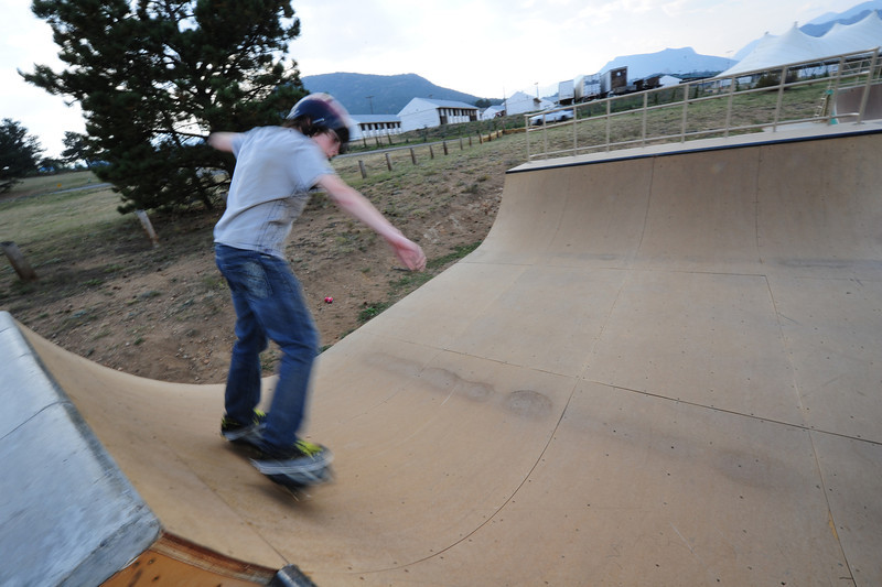 "Walt Hester | Trail-Gazette<br /> Jove Darnell, 13, rides a ""rip stick"" at the youth center's skate park on Wednesday. The new halfpipe offers skaters more challenges at the park."