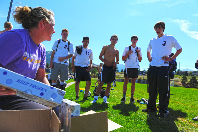 Walt Hester | Trail-Gazette<br /> Head soccer coach Kay Hays distributes cookie dough after Saturday's game. The team sold cookie dough to raise money for the soccer program.