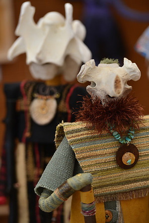 Walt Hester | Trail-Gazette<br /> Bony faces greet visitors to the annual Art and Craft Market in Bond Park on Saturday. Artists created art from a great many different materiels.